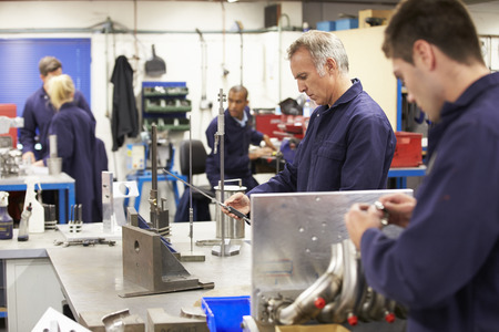 Busy Interior Of Engineering Workshop photo