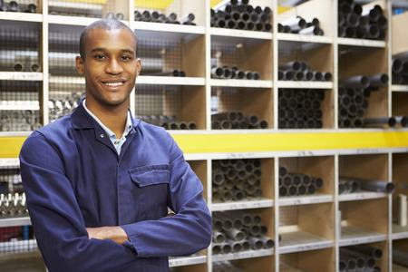 Portrait Of Engineering Worker In Store Room Imagens