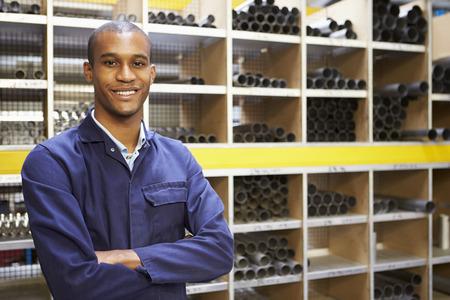 Portrait Of Engineering Worker In Store Room Stok Fotoğraf