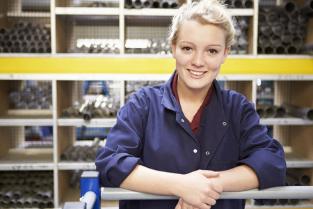 warehouse worker: Portrait Of Female Engineering Apprentice In Store Room
