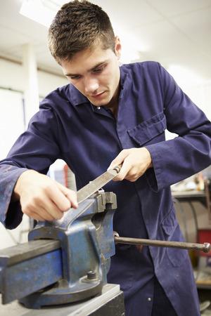 metal worker: Apprentice Engineer Working On Factory Floor Stock Photo