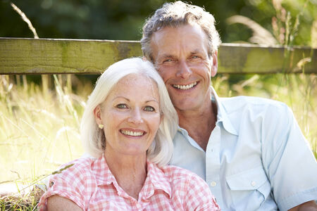 middle aged couple: Middle Aged Couple Relaxing In Countryside Stock Photo