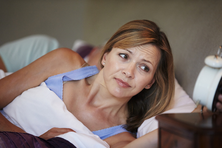 early 40s: Couple In Bed With Wife Suffering From Insomnia