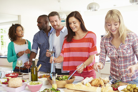 five people: Group Of Friends Having Dinner Party At Home Stock Photo