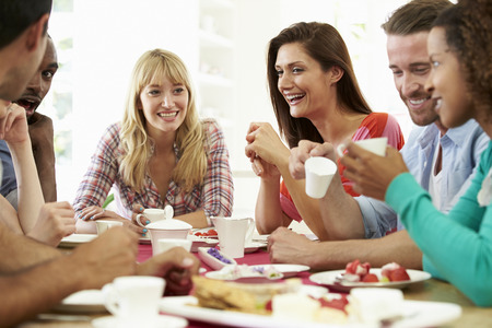 man drinking coffee: Group Of Friends Having Cheese And Coffee Dinner Party Stock Photo