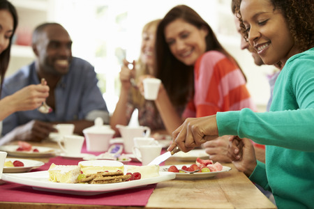 eating pastry: Group Of Friends Having Cheese And Coffee Dinner Party Stock Photo