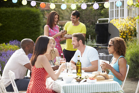 summer drink: Group Of Friends Having Outdoor Barbeque At Home Stock Photo