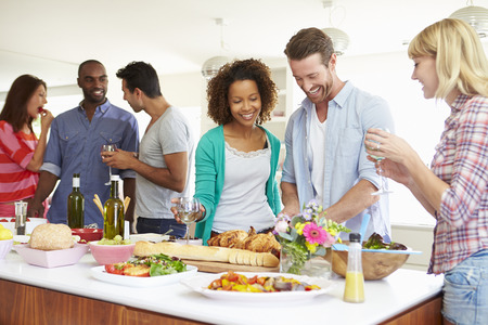 party food: Group Of Friends Having Dinner Party At Home Stock Photo
