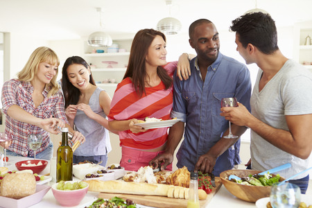 Group Of Friends Having Dinner Party At Home Banco de Imagens