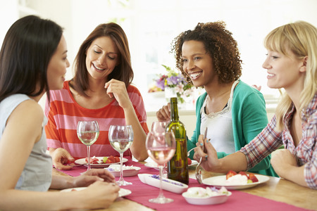 Group Of Women Sitting Around Table Eating Dessert Stok Fotoğraf