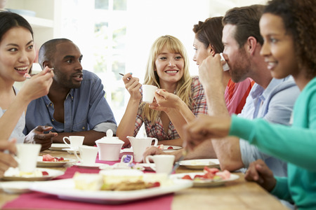 dinner party people: Group Of Friends Having Cheese And Coffee Dinner Party Stock Photo