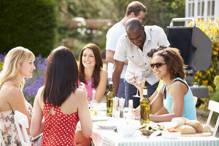 friends having fun: Group Of Friends Having Outdoor Barbeque At Home Stock Photo