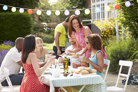 beverage: Group Of Friends Having Outdoor Barbeque At Home Stock Photo