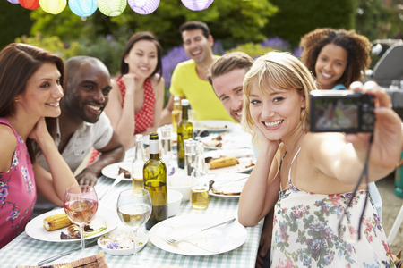 selfie: Friends Taking Self Portrait On Camera At Outdoor Barbeque