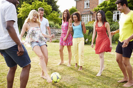 football party: Group Of Friends Playing Football In Garden