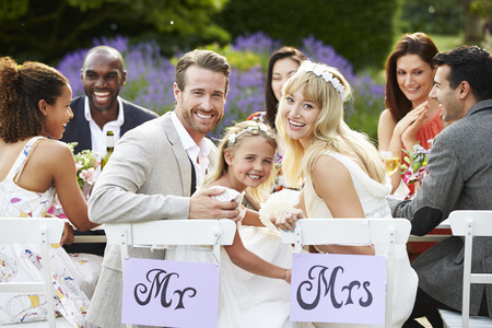 groom: Bride And Groom With Bridesmaid At Wedding Reception Stock Photo