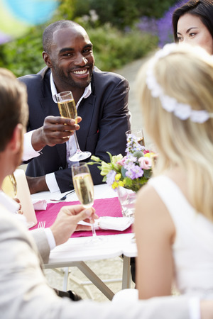Friends Proposing Champagne Toast At Wedding photo