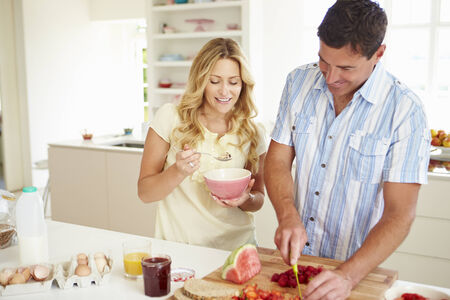 Couple Preparing Healthy Breakfast In Kitchen photo