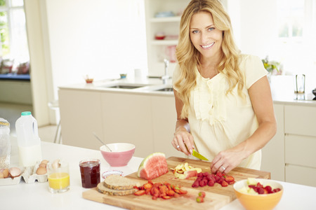 Woman Preparing Healthy Breakfast In Kitchen photo