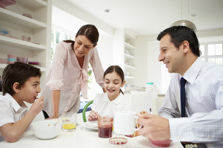 uniforms: Family Having Breakfast Before Husband Goes To Work