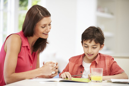 Mother Helping Son With Homework photo