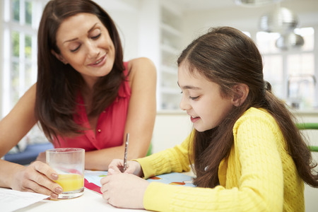 11: Mother Helping Daughter With Homework Stock Photo