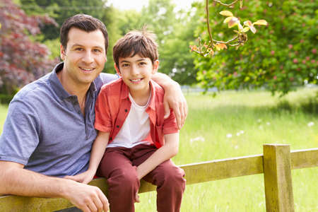 Portrait Of Hispanic Father And Son In Countryside photo