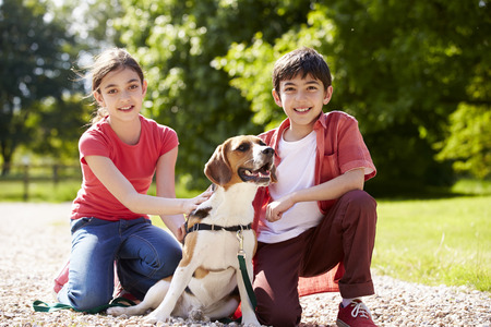 leashes: Hispanic Children Taking Dog For Walk In Countryside Stock Photo