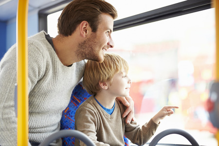 Father And Son Enjoying Bus Journey Together Imagens