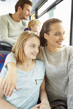 boy 12 year old: Family Enjoying Bus Journey Together