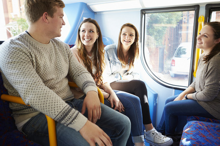 old bus: Group Of Young People On Bus Journey Together