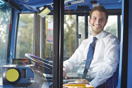 Portrait Of Bus Driver Behind Wheel photo