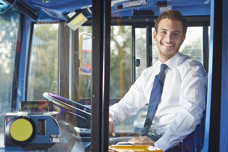 transportations: Portrait Of Bus Driver Behind Wheel Stock Photo