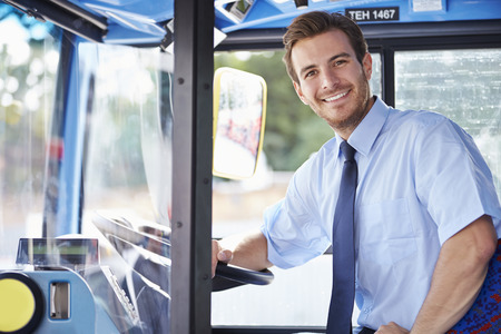 driver: Portrait Of Bus Driver Behind Wheel Stock Photo