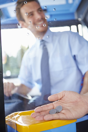 fare: Close Up Of Hand Giving Driver Fare For Bus Journey Stock Photo