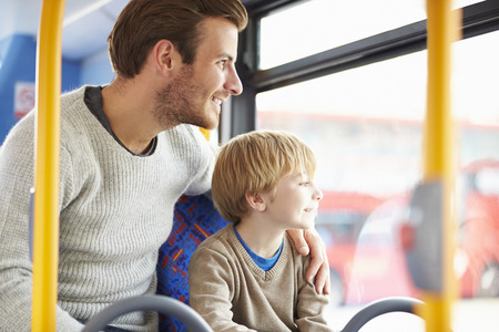 old bus: Father And Son Enjoying Bus Journey Together Stock Photo