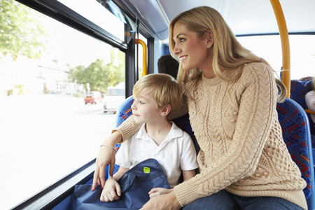 Mother And Son Going To School On Bus Together photo