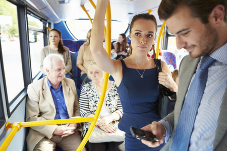 sit: Passengers Standing On Busy Commuter Bus