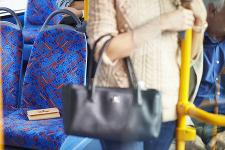 change purse: Passenger Leaving Change Purse On Seat Of Bus