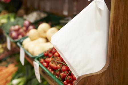 farm shop: Paper Bags By Fruit Counter Of Farm Shop