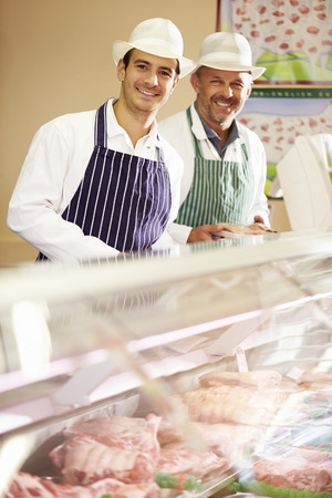 bacon portrait: Two Butchers At Work In Shop