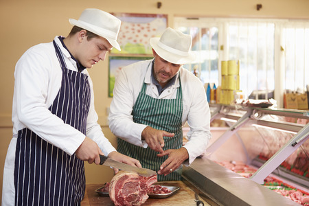 Butcher Teaching Apprentice How To Prepare Meat photo