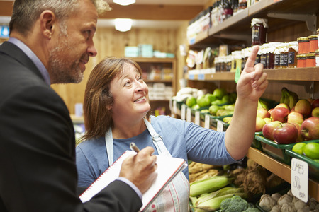 Bank Manager Meeting With Female Owner Of Farm Shop photo