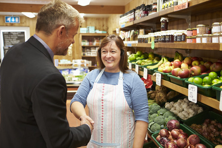 farm shop: Bank Manager Meeting With Female Owner Of Farm Shop Stock Photo