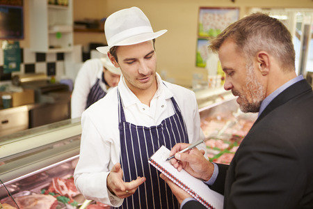 Bank Manager Meeting With Owner Of Butchers Shop