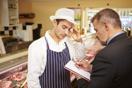 public health: Bank Manager Meeting With Owner Of Butchers Shop