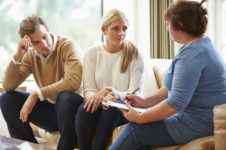 human relationship: Counselor Advising Couple On Relationship Difficulties