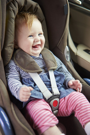 Baby Sitting Happily In Car Seat photo