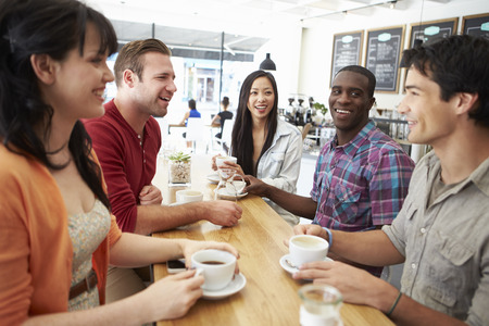 friends drinking: Group Of Friends Meeting In Coffee Shop