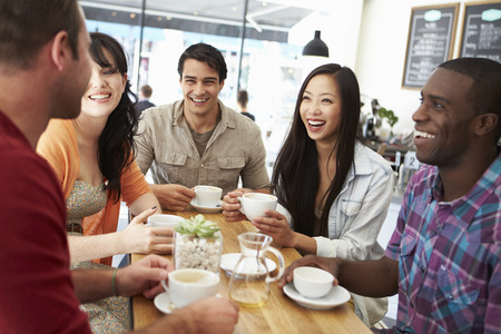 friend: Group Of Friends Meeting In Coffee Shop